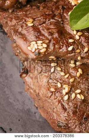 Close up of roasted beef with sesame seeds