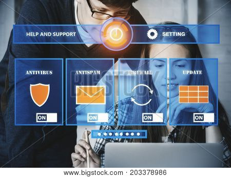 Businessman and woman using laptop withj antivirus interface. Hacker concept