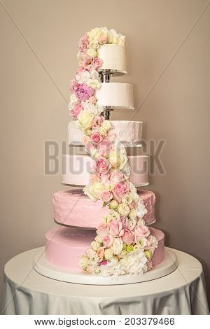 Beautiful Home Wedding Tiered Cake Decorated With Pink Roses