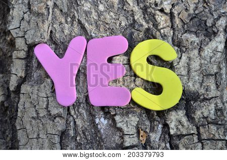 word yes on a  abstract colorful background