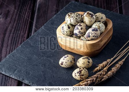 Eco Farm Quail Eggs On Dark Wooden Background. Concept Of Home Made Natural Food