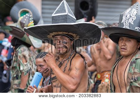 June 29 2017 Cotacachi Ecuador: kichwa indigenous men with extra large hat dancing on the street during Inti Raymi festival