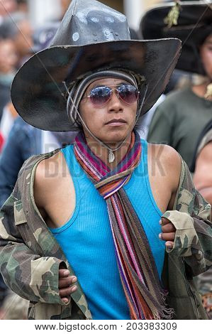 June 29 2017 Cotacachi Ecuador: kichwa indigenous man with extra large hat dancing on the street during Inti Raymi festival