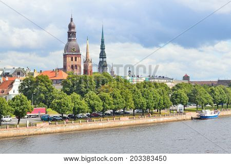 Riga Latvia. Beautiful view of the Daugava quay in a cloudy summer day