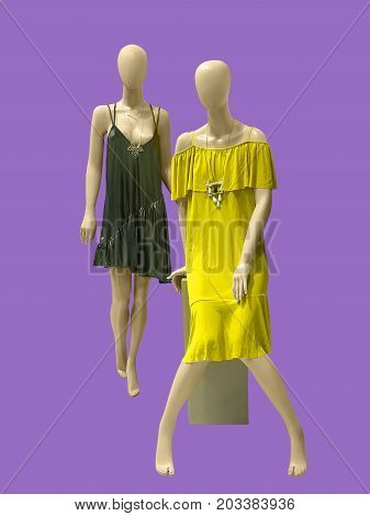 Two female mannequins dressed in fashionable clothes isolated. No brand names or copyright objects.