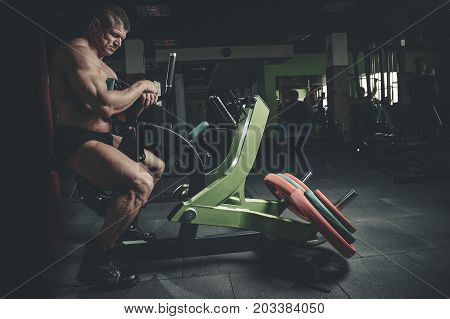 Brutal Caucasian Bodybuilder Working Out In Gym