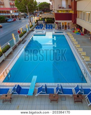 Rimini Italy - June 26 2017: Swimming pool in evening in Ascot hotel Rimini Italy