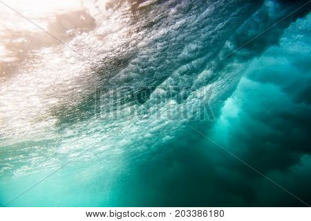 Underwater shot of the sea surface with sunny beams and waves