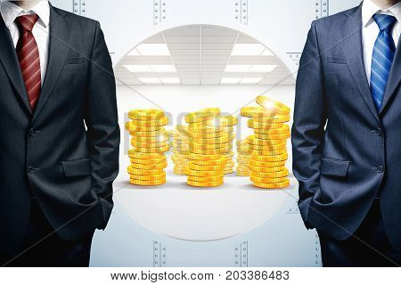 Two unrecognizable businessmen standing next to open bank vault with golden coins. Treasure protection concept. 3D Rendering
