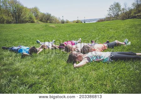A group of friends laying in the grass