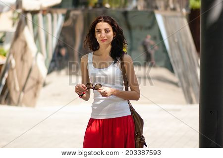 Attractive brunette, looking in frame. Portrait, Prague, May 28, 2017, near the monument to Hlava Franze Kafka
