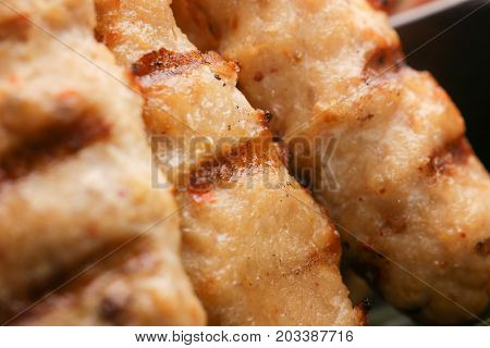 Close up view of minced meat skewers