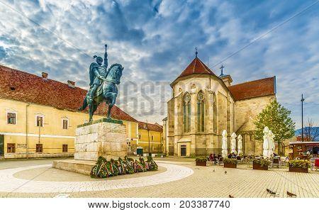 Statue of Michael the Brave and St Michael's Roman Catholic Cathedral in Alba Iulia Transylvania Romania