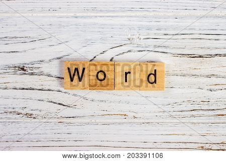 Word word made of round wood blocks on the table