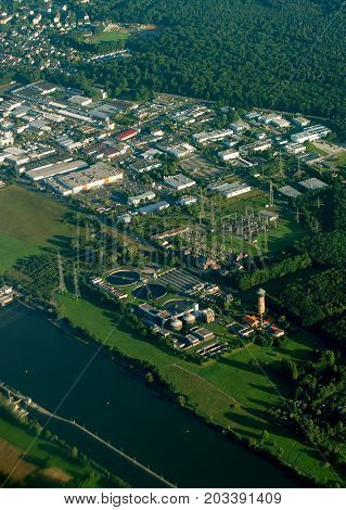 Aerial view of wastewater treatment plant and electrical substation.
