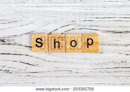 SHOP Word Written In Wooden Cube concept