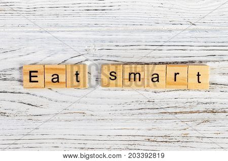 eat smart Word Written In Wooden Cube diet concept