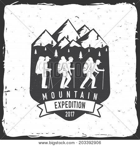 Mountain expedition badge. Vector illustration. Concept for shirt or logo, print, stamp or tee. Vintage typography design with mountaineers and mountain silhouette.