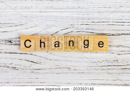 CHANGE word made with wooden blocks concept