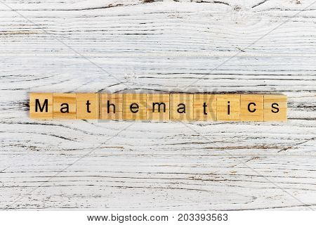 mathematics word made with wooden blocks concept
