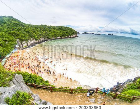 overcrowded beach in Cat Ba Island - it is a popular summer destination for Vietnamese tourists poster