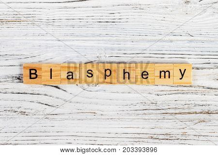 BLASPHEMY word made with wooden blocks concept