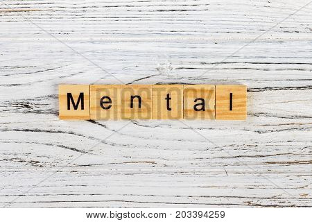MENTAL word made with wooden blocks concept
