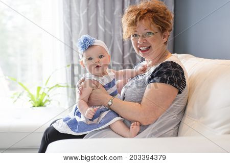 A Grandmother hold little baby girl cute smiling close-up
