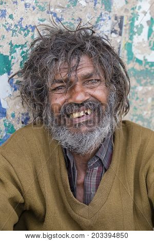 VARANASI INDIA - JANUARY 26 2017 : Portrait homeless person on the ghats of the Ganges river in Varanasi India . Close up