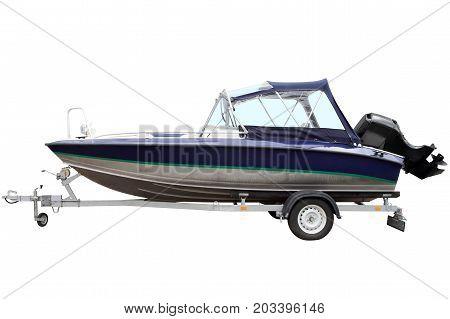 Blue motor boat on a trailer for transportation.