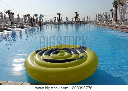 yellow ring floating in a swimming pool