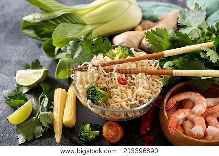 Chinese noodles with shrimps and vegetables in jar fast lunch asian food with chopsticks asian chinese or thai food