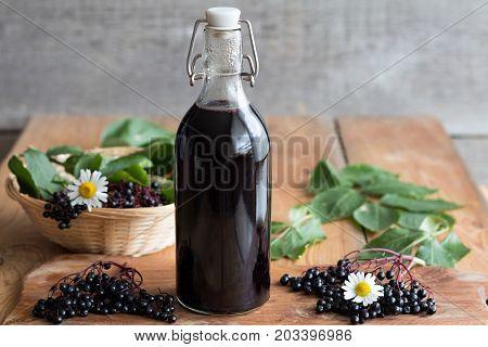 A Bottle Of Freshly Prepared Elderberry Syrup