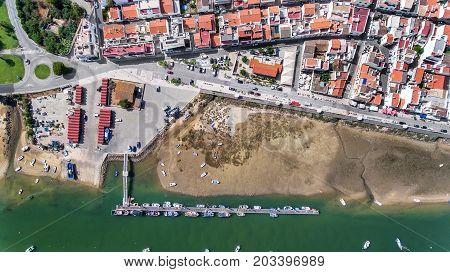 Aerial. Port, pier of fishing ships. Sky view Cabanas Tavira
