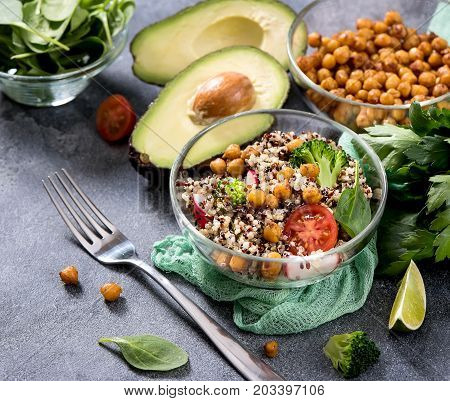 Quinoa salad with chickpeas spinach avocado and veggies healthy vegan food dieting clean eating vitamin and protein snack