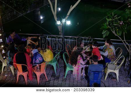 Dhaka, bangladesh, august 2017-indian people enhoying dinner with familiy at night at outdoor near the Amin Bazar Bridge in dhaka in bangladesh taken on 7, september 2017
