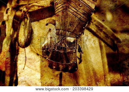 Detail knight armor. Gloves of a knight. Sepia effect