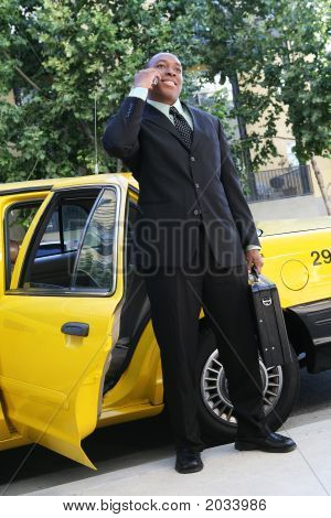 Business Man Exiting Taxi