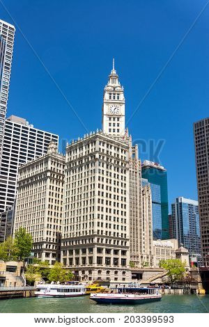 CHICAGO - MAY 12: Wrigley Building and boats in downtown Chicago on May 12 2017