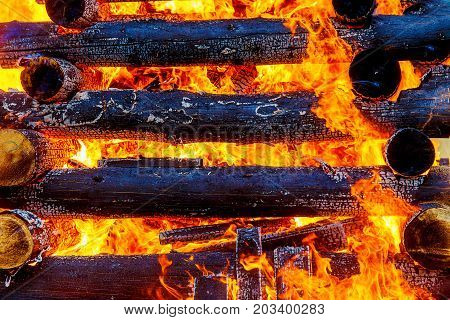 beautiful structure of burning logs and flames of great bonfire