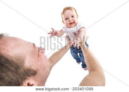 A Men's hands hold the baby on a white background