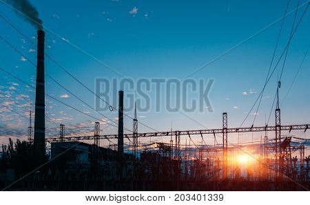 Sun setting over an electrical substation the sunset glow