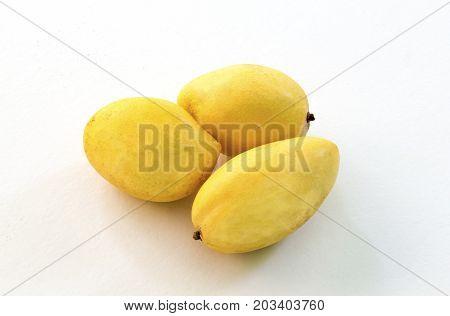 Yellow mango isolated on white background. Ripe golden mango studio photo for food package design. Juicy mango closeup. Tasty natural dessert. Sweet tropical fruit. Exotic fruit snack. Whole mango