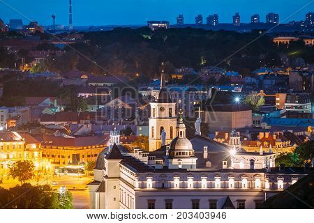 Vilnius, Lithuania, Eastern Europe. Aerial View Of Historic Center Cityscape In Blue Hour After Sunset. Travel View Of Old Town In Night Illuminations. UNESCO. Palace Of The Grand Dukes Of Lithuania
