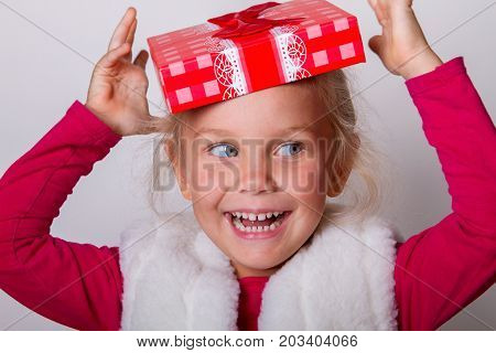 little girl for a joke put a lid on the box on her head instead of a hat.