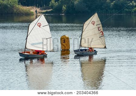sailing regatta of young sailors on the river
