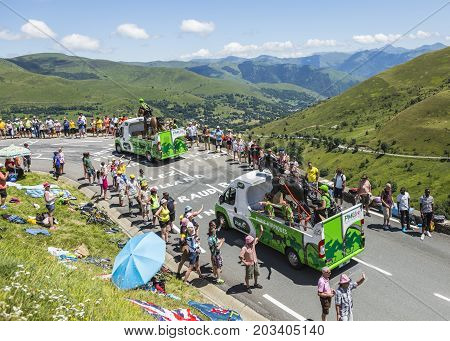 Col de PeyresourdeFrance- July 23 2014: PMU vehicles passing in the Publicity Caravn on the road to Col de Peyresourde in Pyrenees Mountains during the stage 17 of Le Tour de France 2014.