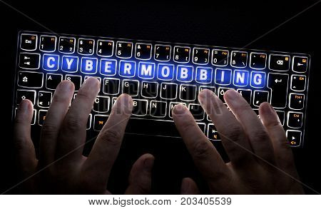 Cybermobbing keyboard is operated by hacker picture