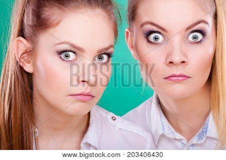 Two Young Women Looking Shocked