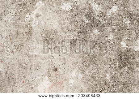 Grunge concrete texture. Beige asphalt road top view photo. Distressed and obsolete background texture. Natural concrete floor top view. Rustic asphalt road surface. Grungy grit backdrop. Shabby chic